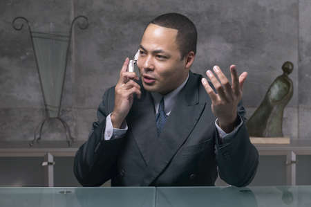 acknowledging: African businessman using cell phone