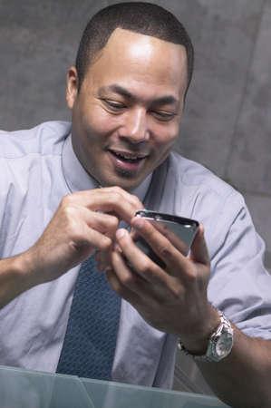African businessman using PDA Stock Photo - 16092296