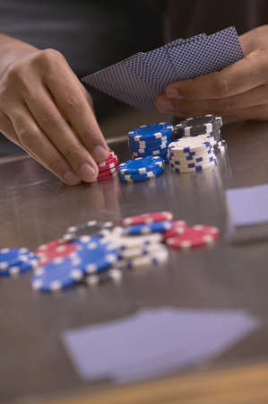 Close up of poker table with man's hands Stock Photo - 16092329