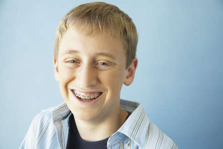 only one teenage boy: Teenaged boy smiling with braces