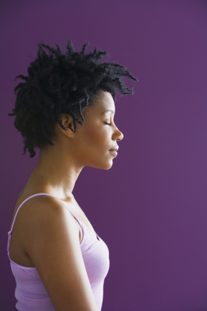 'eyes shut: Side view of African woman with eyes closed