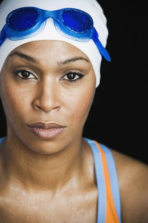 African woman wearing swimming cap and goggles Stock Photo