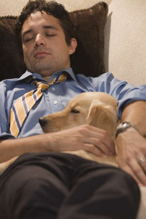 wearying: Dad after Work Asleep with Dog LANG_EVOIMAGES