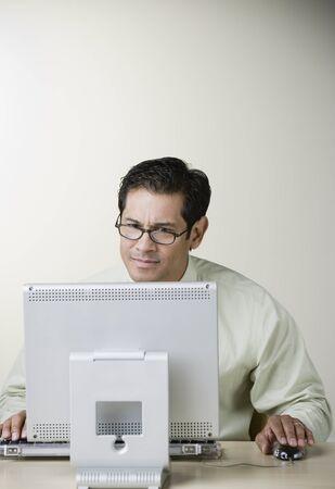 Hispanic man working on computer
