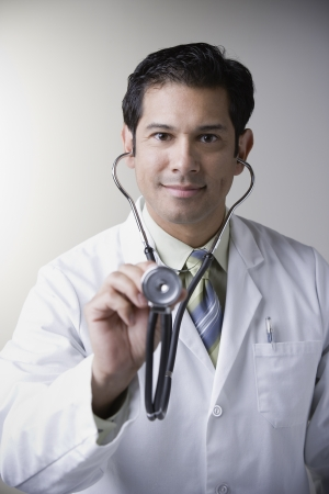 Hispanic male doctor with stethoscope Stock Photo - 16092410