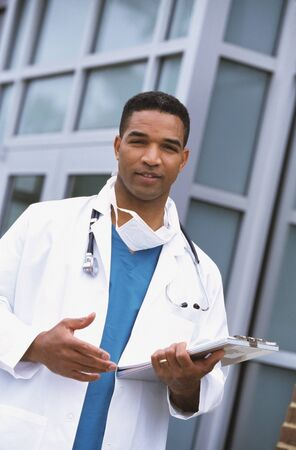 African male doctor holding chart outdoors Stock Photo - 16092418