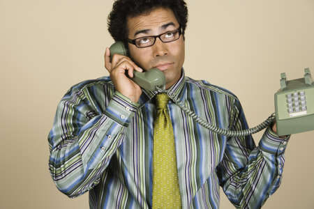 Native American businessman talking on telephone Stock Photo - 16092443