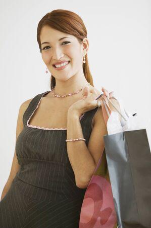 relishing: Hispanic woman holding shopping bags