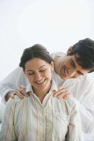 Hispanic man giving wife shoulder massage Stock Photo - 16092457