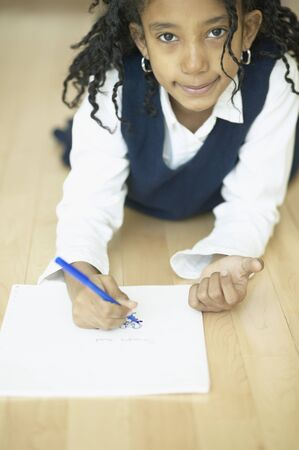 jamaican ethnicity: Close up of African girl drawing LANG_EVOIMAGES