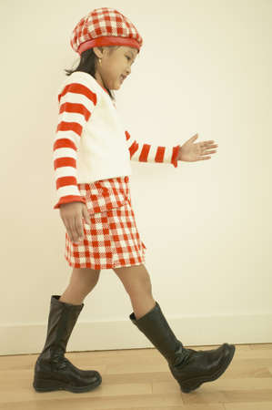 stepping: Young Asian girl walking