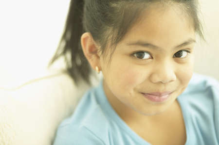 filipino ethnicity: Close up of Asian girl smiling