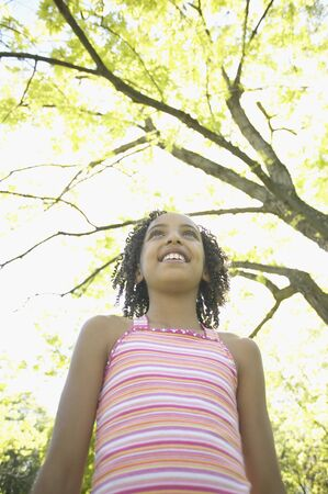 spectating: Low angle view of African girl outdoors