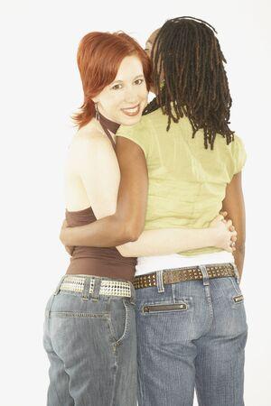 twenty two: Studio shot of female couple hugging
