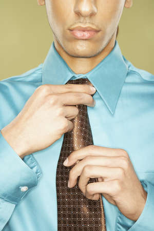 Middle Eastern businessman adjusting necktie Stock Photo - 16092533