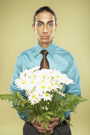 Middle Eastern businessman holding bouquet of flowers Stock Photo - 16092537