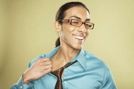 Middle Eastern businessman pulling off necktie Stock Photo - 16092540