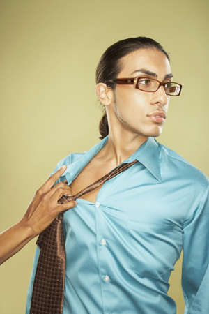 Woman pulling off Middle Eastern businessman's necktie Stock Photo - 16092542