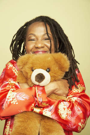 Middle-aged African woman hugging teddy bear Stock Photo - 16092548