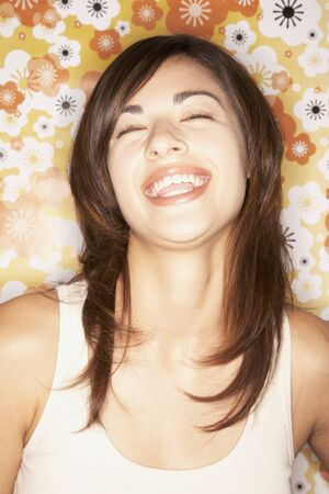mischievious: Close up of Asian woman laughing