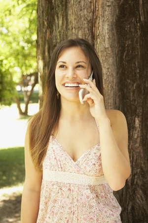 Hispanic woman talking on cell phone outdoors Stock Photo - 16092577