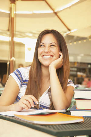 Hispanic woman at cafe table with school books Stock Photo - 16092578