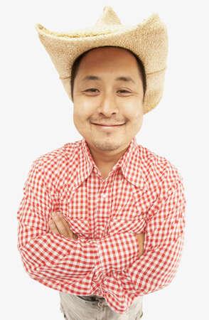 Studio shot of Asian man wearing cowboy hat Stock Photo - 16092580