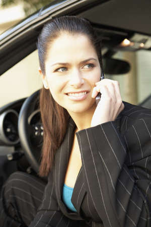 Businesswoman talking on cell phone in car Stock Photo - 16092584