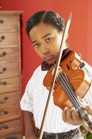 African boy playing violin Stock Photo - 16092591