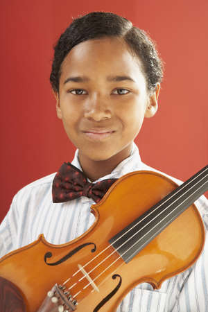 African boy holding violin Stock Photo - 16092592