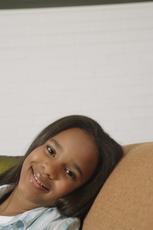 African girl smiling on sofa Stock Photo - 16092618