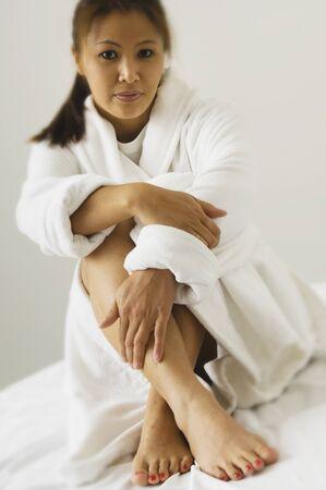 casualness: Portrait of Asian woman wearing bathrobe
