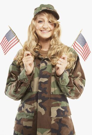 Woman wearing military uniform and holding American flags Stock Photo - 16092639