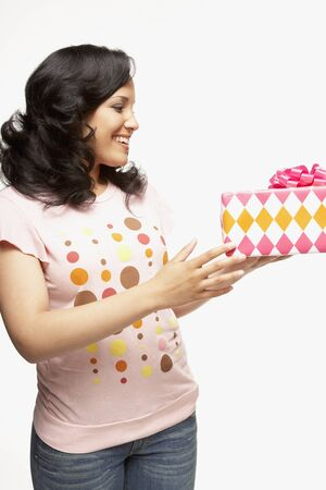 African woman holding gift Stock Photo