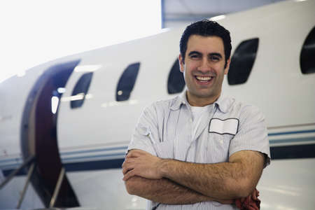 Repairman smiling in front of airplane Stock Photo - 16092674