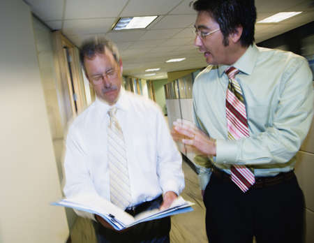 Two businessmen talking in hallway Stock Photo - 16092680