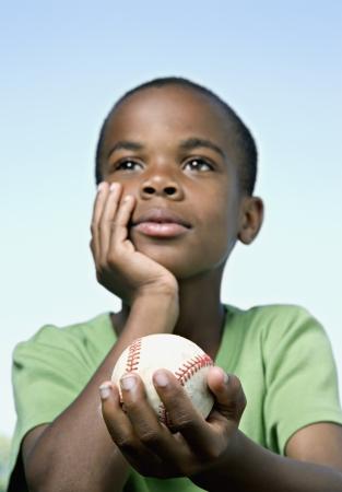 African boy holding baseball 免版税图像