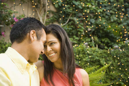 Hispanic couple smiling at each other outdoors Stock Photo - 16092709