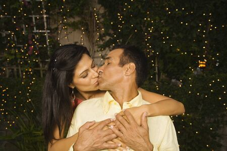 Hispanic couple kissing outdoors at night Stock Photo - 16092710