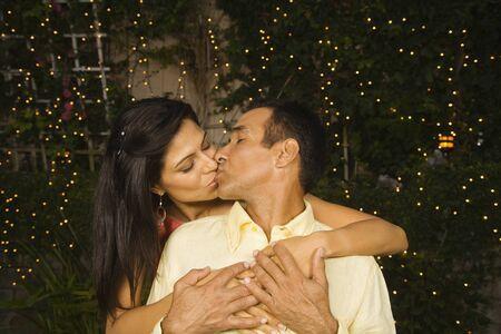 Hispanic couple kissing outdoors at night Stock Photo - 16092710