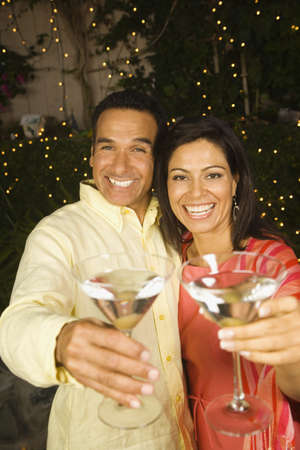 Hispanic couple toasting with cocktails at night Stock Photo - 16092711
