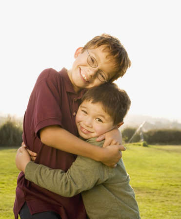 Portrait of Asian brothers hugging Stock Photo - 16092736