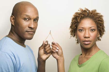African couple holding wishbone Stock Photo - 16092746