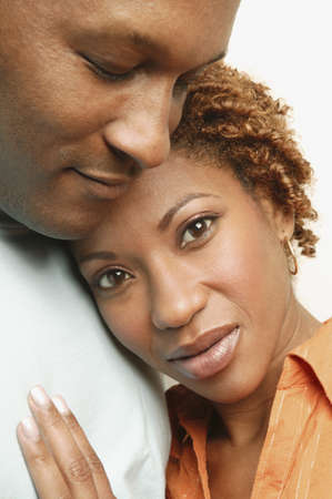 'head and shoulders': Close up of African couple hugging