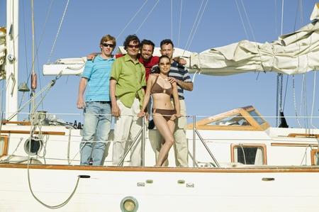unconcerned: Portrait of multi-ethnic friends on sailboat