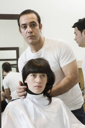 seriousness skill: Male hair stylist working on female client