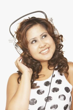 Asian woman listening to headphones Stock Photo - 16092783