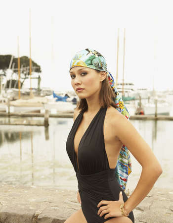 Asian woman wearing bathing suit at marina Stock Photo - 16092802
