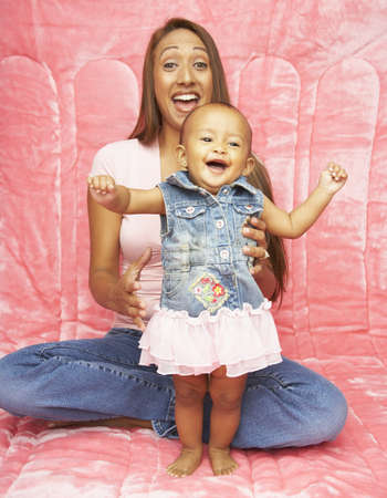 native american baby: Mother and baby daughter laughing LANG_EVOIMAGES