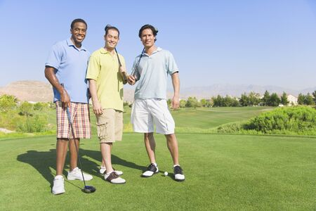 Portrait of three men on golf course